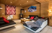 Chalets-Lacuzon-Snow-Dream-Cosy-lounge-with-stove